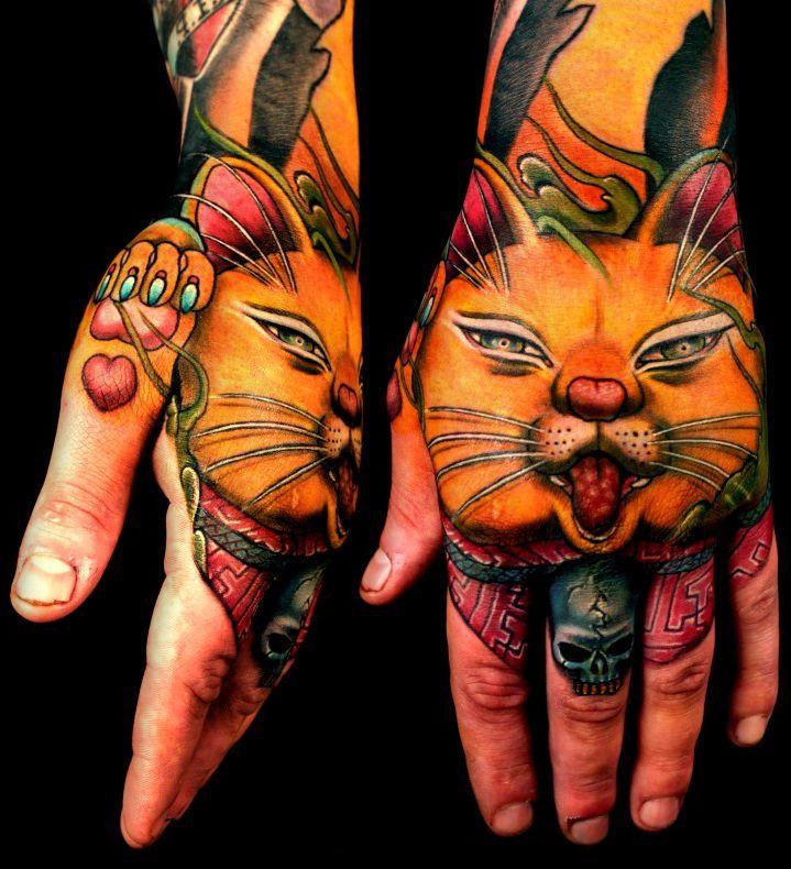 kotek tatuaż