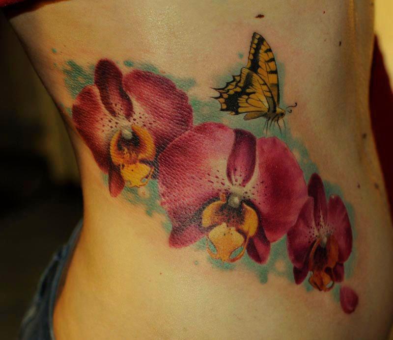 kwiaty motyle tatuaże