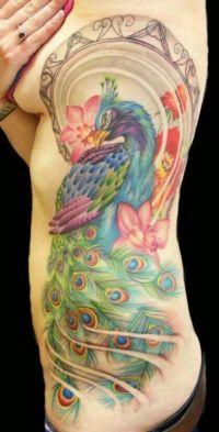 feniks tatuaż na żebrach
