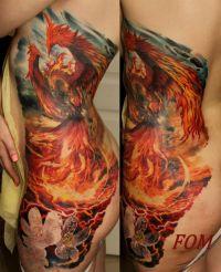 feniks tatuaże na żebrach