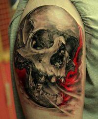 czaszka tatuaż na udzie